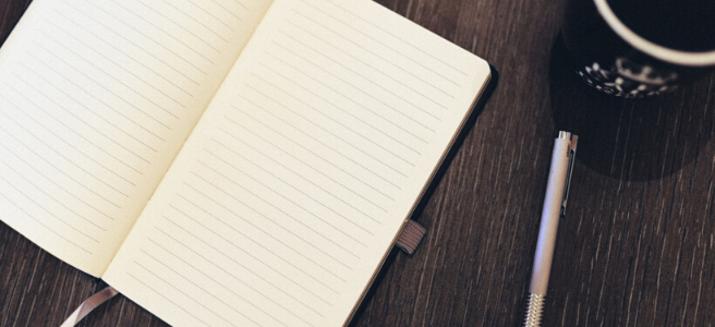 Image shows a blank notepad and a pen. Once you've written your essay, I can proofread it for you.